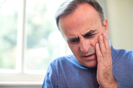 An older man with tooth pain.