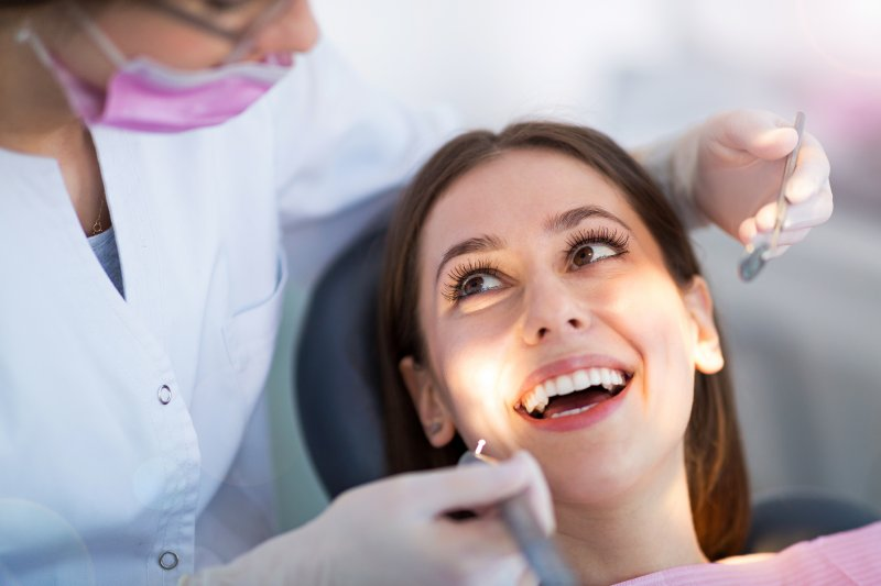 Patient smiling at routine dental appointment